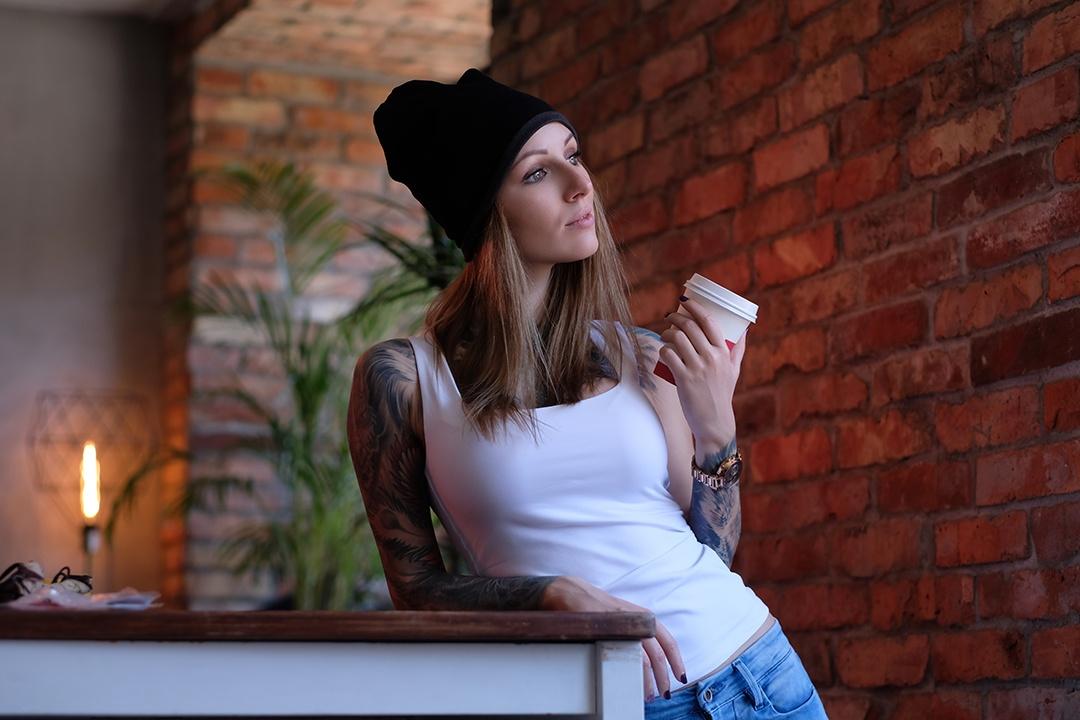 portrait-of-a-tattooed-blonde-hipster-girl-in-a-ro-AUJRK7L.jpg