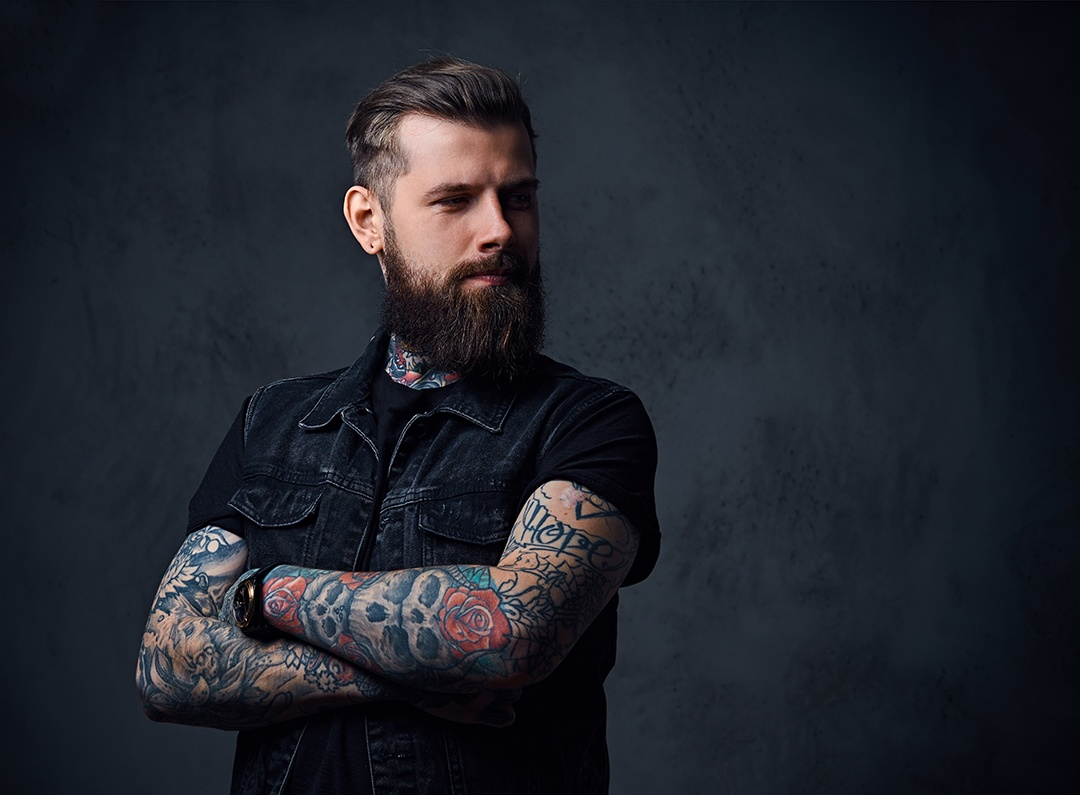 studio-portrait-of-bearded-hipster-male-with-tatto-MQVXECP.jpg